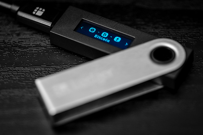 Hardware crypto wallet: the Ledger Nano S connected to a computer.