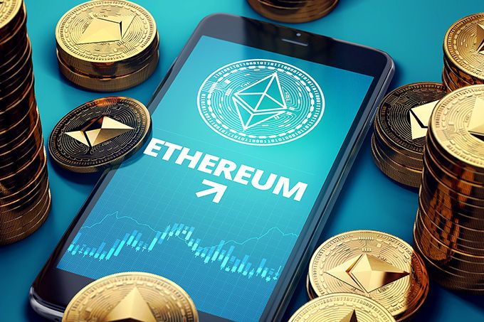 Best Ethereum wallet: a phone with Ether coins scattered around.