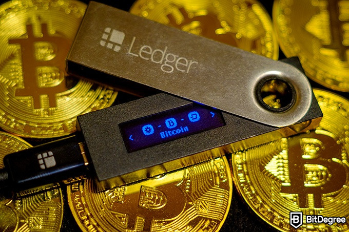 Tron wallet: the Ledger Nano S on a pile of Bitcoins.