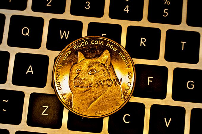 What is Dogecoin: a Dogecoin on a keyboard.