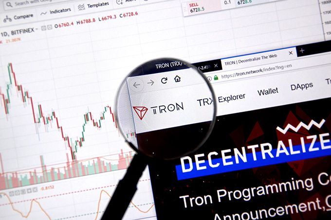 What is Tron Coin: the Tron website in front of a chart.