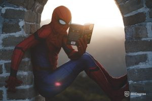 spider-man learning on the wall