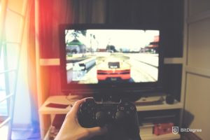 Person playing a video game through console
