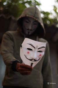 what is cybersecurity - a person with vendetta mask